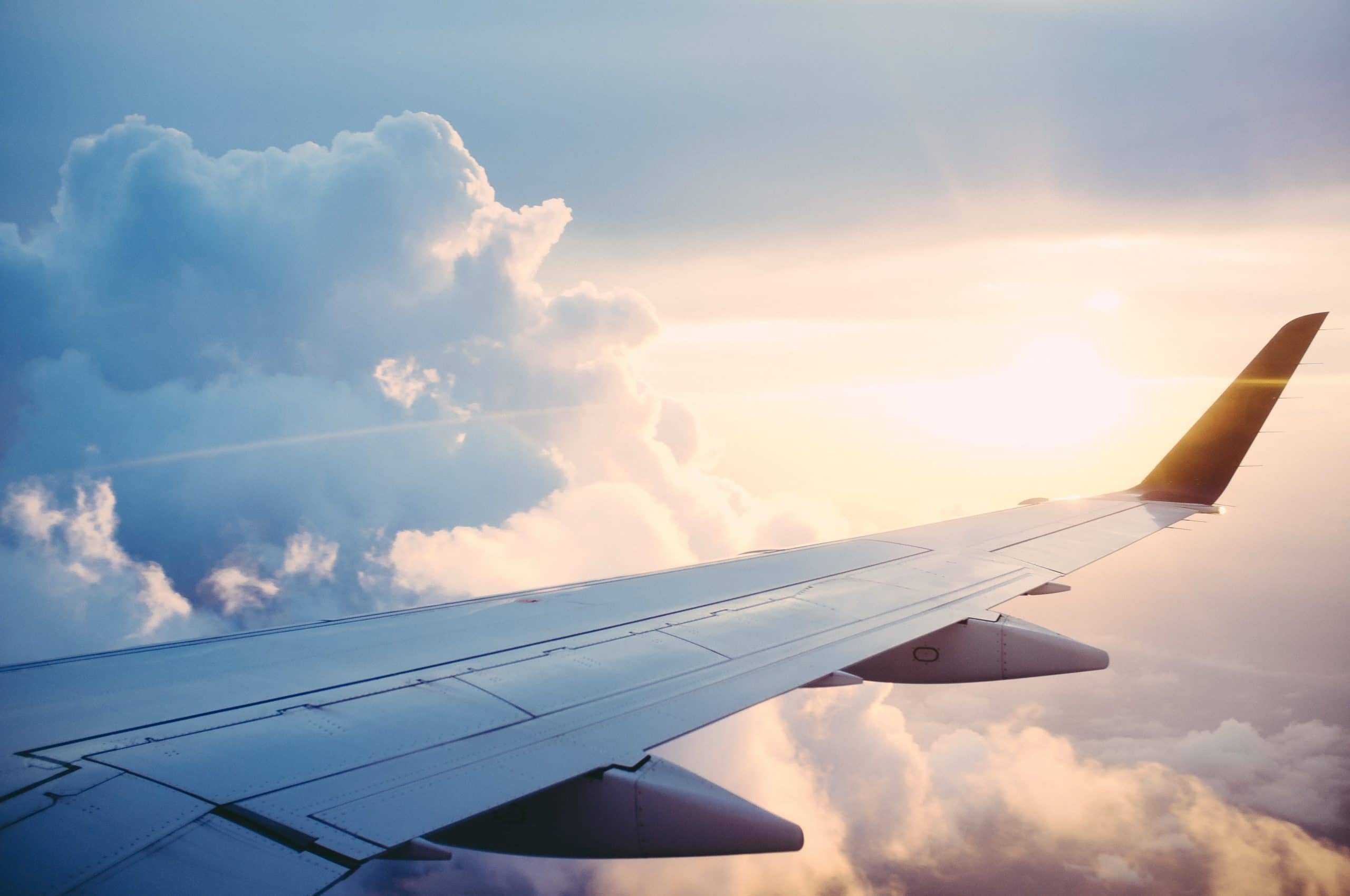 Airport transfers Sunshine Coast to Noosa - airplane in the sky with clouds